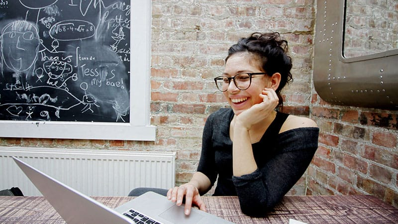 woman smiling and typing