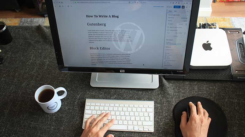 blogger typing on keyboard